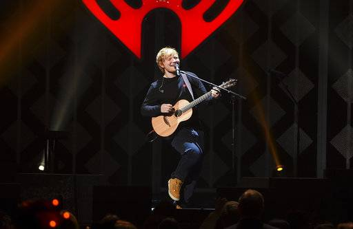 "FILE - In this Dec. 8, 2017, file photo, singer-songwriter Ed Sheeran performs at Z100's iHeartRadio Jingle Ball at Madison Square Garden, in New York. Sheeran's album ""Divide� was the most popular album of 2017, helping the music industry enjoy a growth spurt during the year, according to Nielsen Music. (Photo by Evan Agostini/Invision/AP, File)"