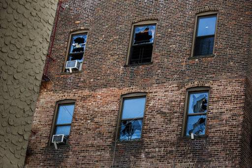 FILE- This Friday, Dec. 29, 2017, file photo shows broken windows on the back of the building where more than 10 people died in a fire in the Bronx borough of New York. Police say Holt Francis was critically injured in the apartment building fire and died at a hospital on Thursday, Jan. 4, 2018. It was one of New York City's deadliest fires in decades.