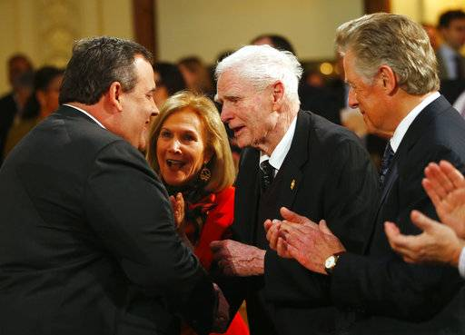 FILE – In this Feb. 26, 2013, file photo, former New Jersey Gov. Brendan Byrne, center, shakes hands with New Jersey Gov. Chris Christie, left, as Byrne's wife Ruthi Zinn Byrne, second from left, and former New Jersey Gov. James Florio, right, clap after Christie outlined his 2014 state budget proposals in Trenton, N.J. Byrne, a Democrat who served as New Jersey governor from 1974 to 1982, died Thursday, Jan. 4, 2018, at age 93. (AP Photo/Rich Schultz, File)
