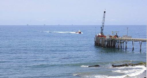 This May 16, 2015 photo shows oil drillings offshore of a service pier in the Santa Barbara Channel off the coast of Southern California near Carpinteria. The Trump administration on Thursday, Jan. 4, 2018 moved to vastly expand offshore drilling from the Atlantic to the Arctic oceans with a plan that would open up federal waters off the California coast for the first time in more than three decades. The Channel is one of those areas.