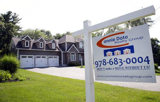 FILE - This Monday, July 10, 2017, file photo shows a house for sale in North Andover, Mass. On Thursday, Jan. 4, 2018, Freddie Mac reports on the week's average U.S. mortgage rates. (AP Photo/Elise Amendola, File)