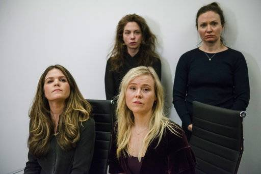 Plaintiffs, from left, Diana Bentley, Hannah Miller, Kristin Booth and Patricia Fagan attend a news conference after filing lawsuits alleging sexual harassment from Souplpepper Theatre Company director Albert Schultz, in Toronto, on Thursday, Jan. 4, 2018. (Christopher Katsarov/The Canadian Press via AP)