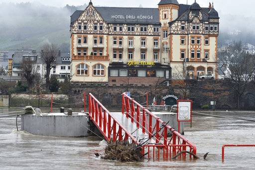 A landing stage is flooded at river Moselle in Bernkastel-Kues, Germany, Thursday, Jan. 4, 2018. German news agency dpa reported Thursday that the Moselle river was closed to all shipping, with water levels 4 meters (13 feet) higher than usual after heavy rainfalls. (Harald Tittel/dpa via AP)