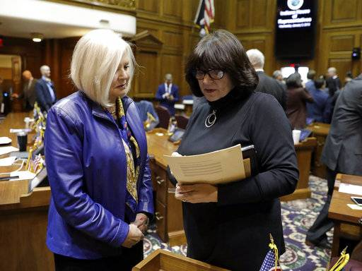 State Rep. Linda Lawson, right, D-Hammond, talks with state Rep. Terri Austin following the opening day of the General Assembly session at the Statehouse, Wednesday, Jan. 3, 2018, in Indianapolis. (AP Photo/Darron Cummings)