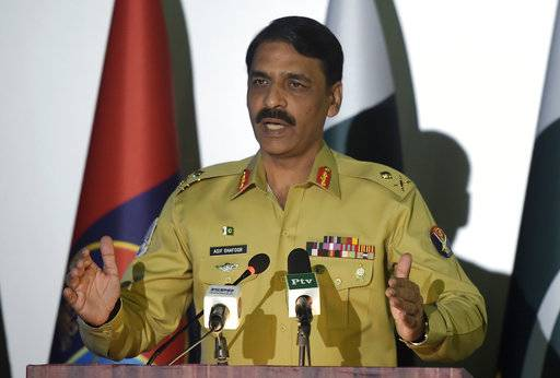 "FILE - In this Monday, April 17, 2017, file photo, Pakistan's army spokesman Maj. Gen. Asif Ghafoor addresses a news conference in Rawalpindi, Pakistan. Ghafoor told that Pakistan wants to continue cooperation with the U.S. but will not ""compromise on national interests and prestige."" (AP Photo/Anjum Naveed)"
