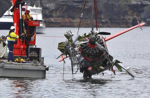 NSW police and salvage personnel work to recover the wreckage of a seaplane that crashed into the Hawkesbury River, north of Sydney, New South Wales, Australia Thursday, Jan. 4, 2018. The seaplane, manufactured in 1963, crashed into the Hawkesbury River Sunday on a return flight to Sydney after a New Year's Eve lunch.(Mick Tsikas/AAP Images via AP)