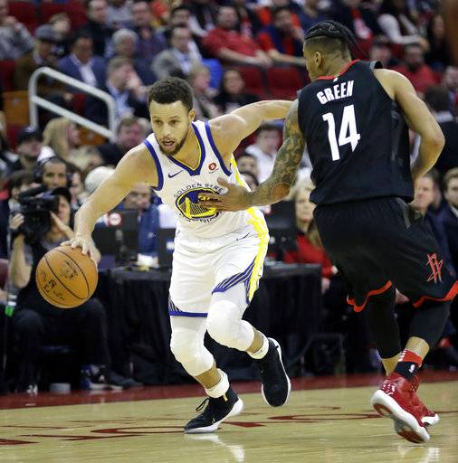 Golden State Warriors' Stephen Curry, left, drives toward the basket as Houston Rockets' Gerald Green (14) defends during the first half of an NBA basketball game Thursday, Jan. 4, 2018, in Houston.