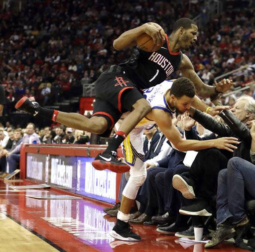 Houston Rockets' Trevor Ariza (1) collides with Golden State Warriors' Stephen Curry during the second half of an NBA basketball game Thursday, Jan. 4, 2018, in Houston.