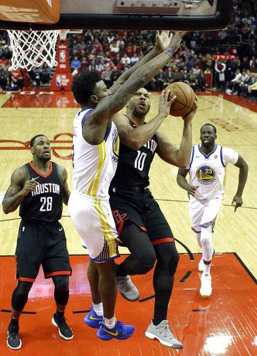 Houston Rockets' Eric Gordon (10) goes up for a a shot as Golden State Warriors' Nick Young defends during the first half of an NBA basketball game Thursday, Jan. 4, 2018, in Houston.