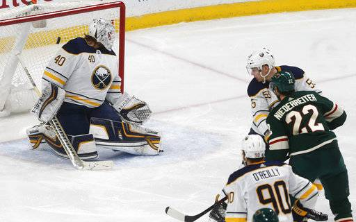 Minnesota Wild's Nino Niederreiter, right, of Switzerland, scores one of his two goals in the first period of an NHL hockey game off Buffalo Sabres goalie Robin Lehner, left, of Sweden, Thursday, Jan. 4, 2018, in St. Paul, Minn. (AP Photo/Jim Mone)