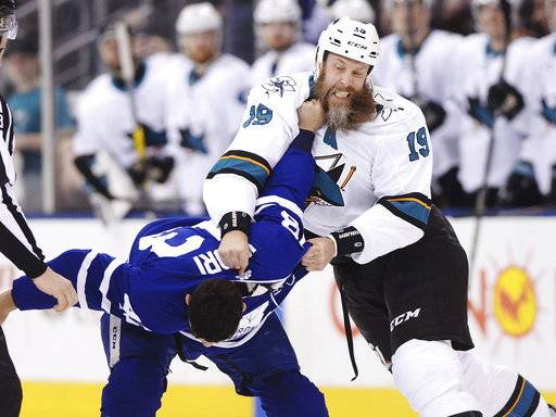 San Jose Sharks' Joe Thornton, right, fights with Toronto Maple Leafs' Nazem Kadri during the first period of an NHL hockey game Thursday, Jan. 4, 2018, in Toronto. (Frank Gunn/The Canadian Press via AP)