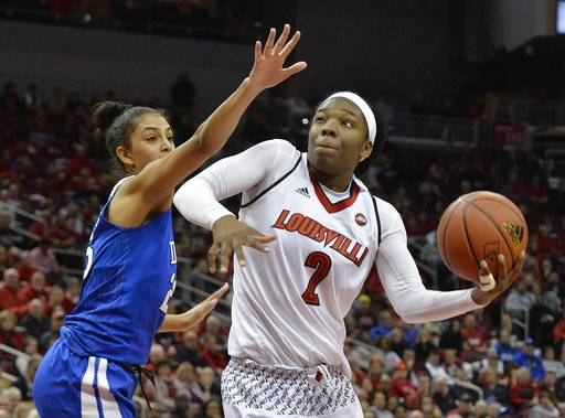Louisville forward Myisha Hines-Allen (2) spins around the defense of Duke forward Jade Williams (25) during the second half of an NCAA college basketball game, Thursday, Jan. 4, 2018, in Louisville, Ky. Louisville won 66-60. (AP Photo/Timothy D. Easley)