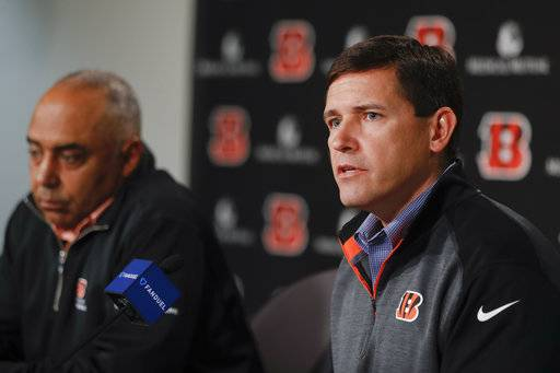 Cincinnati Bengals NFL football offensive coordinator Bill Lazor, right, speaks alongside head coach Marvin Lewis during a news conference following an announcement that they will remain in their positions for an additional two seasons, Wednesday, Jan. 3, 2018, in Cincinnati. (AP Photo/John Minchillo)