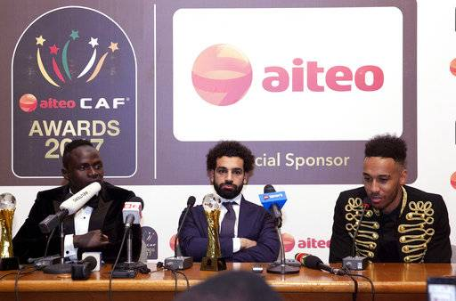 Winner of the African Player of the Year award Mohamed Salah, center, Sadio Mane of Senegal, left, and Pierre-Emerick Aubameyang of Gabon, right, attend a news conference after at the Confederation of African Football awards ceremony in Accra, Ghana, Thursday Jan. 4, 2018. Salah won the award for success on all fronts in 2017 for the Egypt forward after he inspired his country to a long-awaited World Cup place and had a phenomenal start to his career at Liverpool. (AP Photo/Christian Thompson)