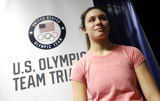 In this Wednesday, Jan. 3, 2018 photo, Blair Cruikshank talks to a reporter during the U.S. Olympic long track speedskating trials in Milwaukee. There's a new Blair in speedskating. And she's the teenage daughter of Olympic speedskating star Bonnie Blair. Blair Cruikshank competes in the 500 meters at the U.S. Olympic trials on Friday. (AP Photo/Morry Gash)