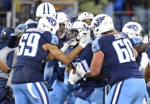FILE - In this Sunday, Dec. 31, 2017, file photo, Tennessee Titans free safety Kevin Byard (31) celebrates with Wesley Woodyard (59) and Ben Jones (60) after intercepting a pass against the Jacksonville Jaguars to stop their final drive in the last seconds of the fourth quarter in an NFL football game in Nashville, Tenn.  Bayard heads into his first playoff game Saturday in Kansas City leading the NFL in takeaways with 10 and tied for the league-lead with eight interceptions.
