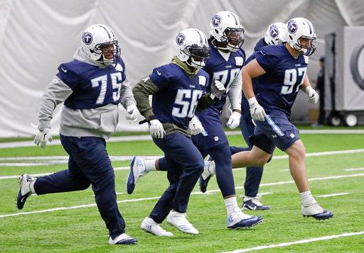 Tennessee Titans defensive linemen work out during an NFL football practice, Thursday, Jan. 4, 2018, in Nashville, Tenn. The Titans are scheduled to play the Kansas City Chiefs Saturday in an AFC wild-card playoff game.