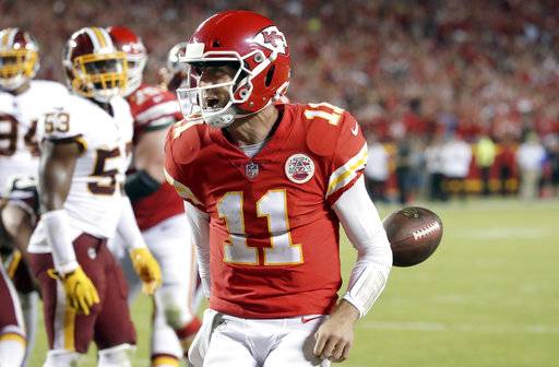 FILE - In this Oct. 2, 2017, file photo, Kansas City Chiefs quarterback Alex Smith (11) celebrates his touchdown during the second half of an NFL football game against the Washington Redskins in Kansas City, Mo. The Jaguars, Bills and Titans all ended long droughts to return to the playoff party.