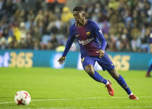 Barcelona's Ousmane Dembele chases the ball during a Copa del Rey round of 16, 1st leg soccer match between Celta and Barcelona at the Balaidos stadium in Vigo, Spain, Thursday Jan. 4, 2018. (AP Photo/Lalo R. Villar)