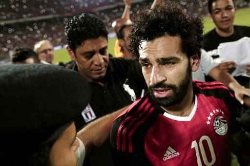 FILE - In this Oct. 8, 2017 file photo, Egypt's Mohamed Salah celebrates after defeating Congo during the 2018 World Cup group E qualifying soccer match at the Borg El Arab Stadium in Alexandria, Egypt. Salah, one of the hottest soccer players in the world right now, was once rejected by his local team. That he succeeded anyway is being latched onto by fellow Egyptians as a sign of hope for a country for years mired by political instability and violence, deadly terrorist attacks and an economic crisis. (AP Photo/Nariman El-Mofty, File)