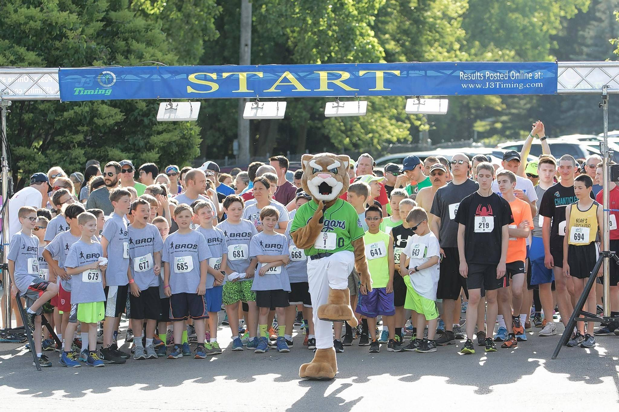 Ozzie, the mascot for the Kane County Cougars, leads off the sixth annual 5K run/walk June 3, dedicated to first responders. A total of $2,000 was donated to local police and fire departments.
