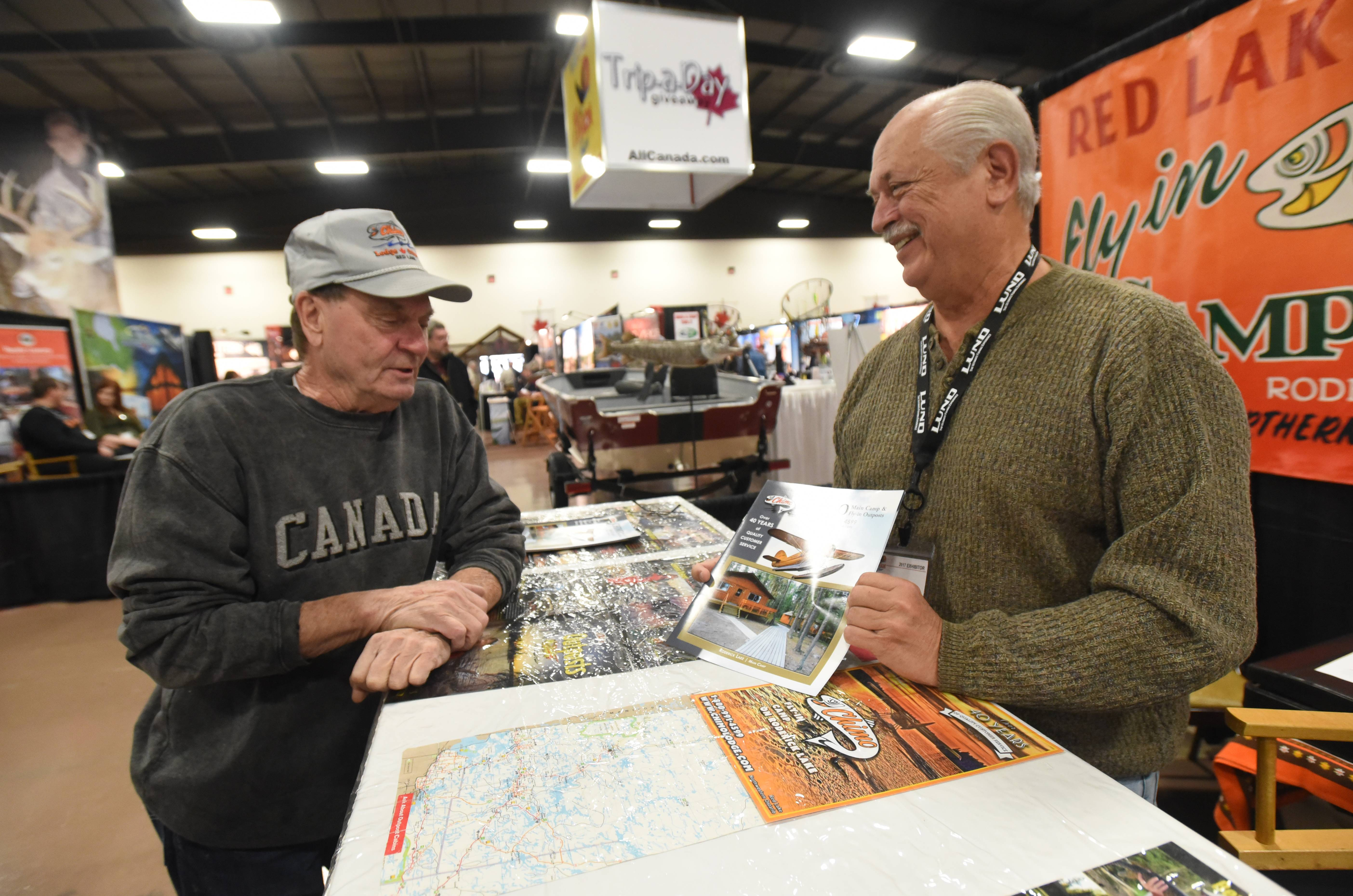 Fred Zorn of Schaumburg, left, and Nick Griffin of Red Lake, Ontario talk fishing trips at last year's All-Canada Show at the Pheasant Run Mega Center in St. Charles.