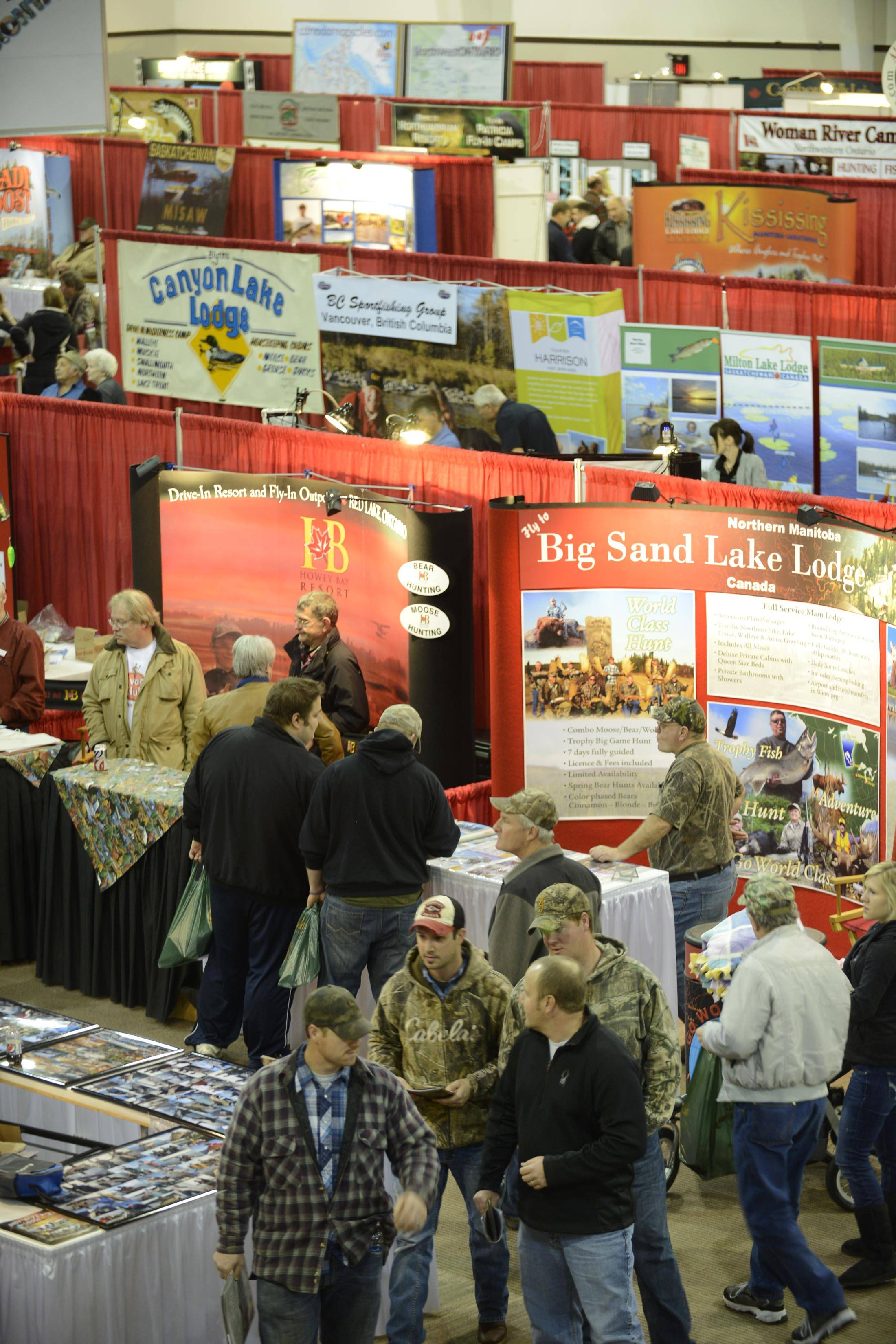 Sportsmen and women wander through a previous All-Canada Show at the Pheasant Run Resort in St. Charles. At this year's show about 150 Canadian lodges and resorts are expected to exhibit.