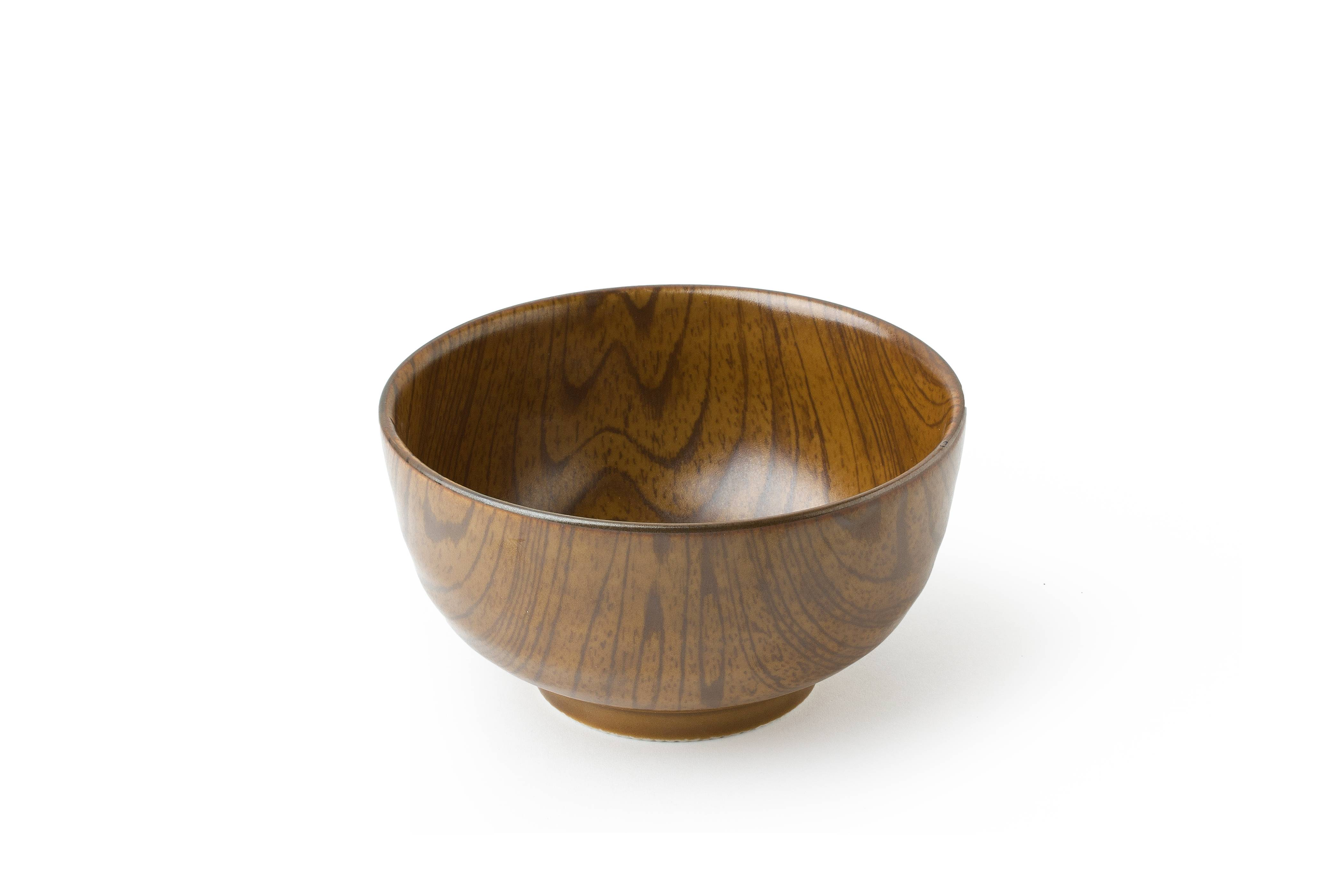 The surprise of this bowl is that it's not wood at all, but a realistically-patterned ceramic.