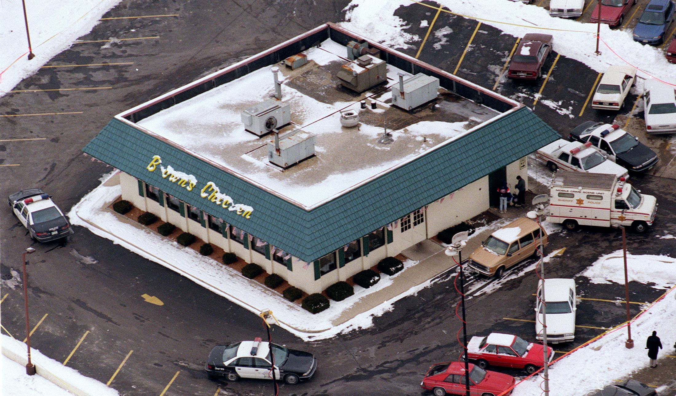 "An aerial view of the Brown's Chicken & Pasta in Palatine, where seven people were killed in a robbery on Jan. 8, 1993. The killing that came to be known as the ""Brown's Chicken massacre"" began a downward spiral for the popular fried chicken chain."