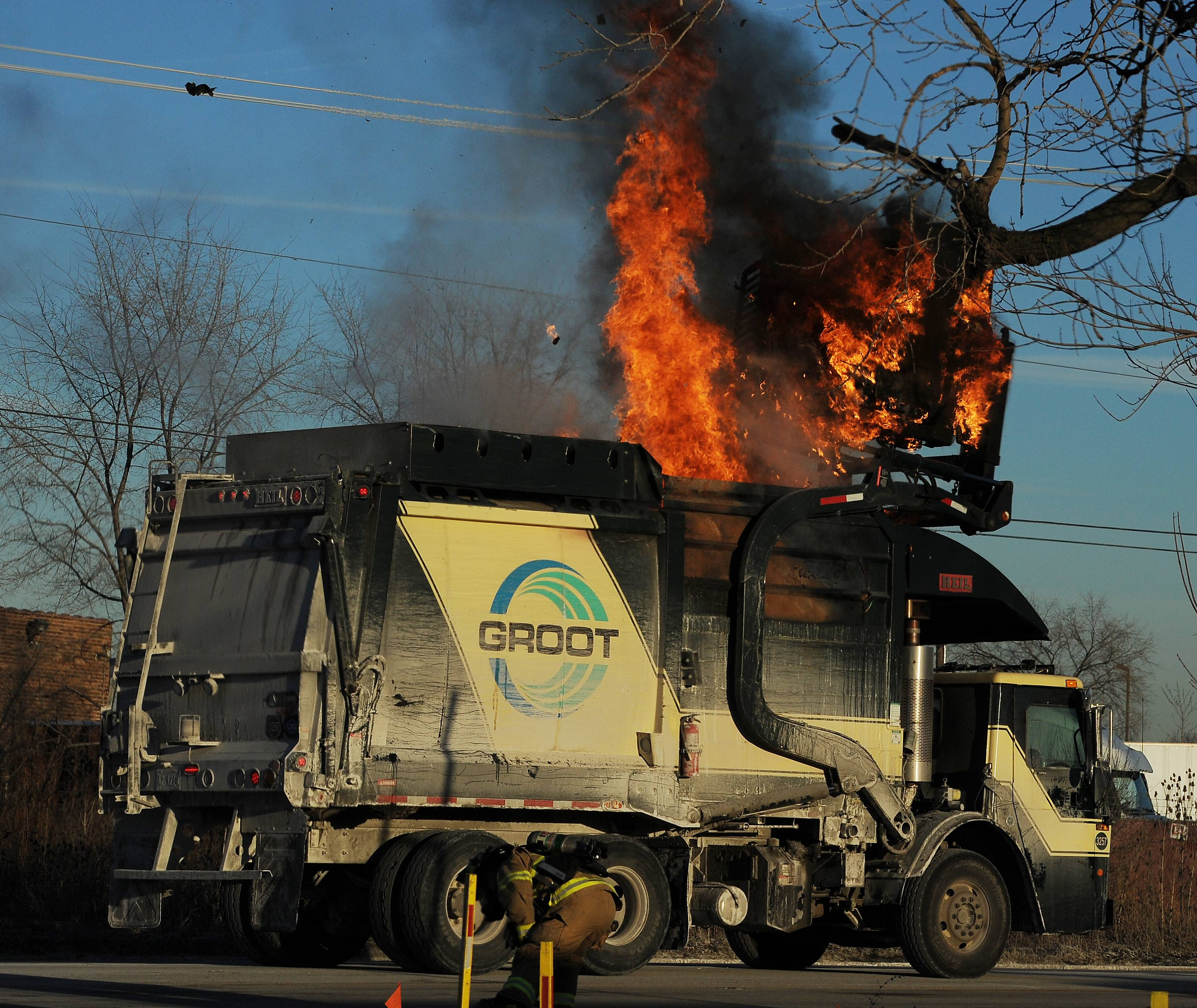 Elk Grove firefighters responded to a Groot garbage truck on fire on Route 72 in unincorporated Elk Grove Township on Saturday afternoon. The fire department dumped the load of garbage on to Higgins Road to get to the heart of the fire, which started in the refuse bin.