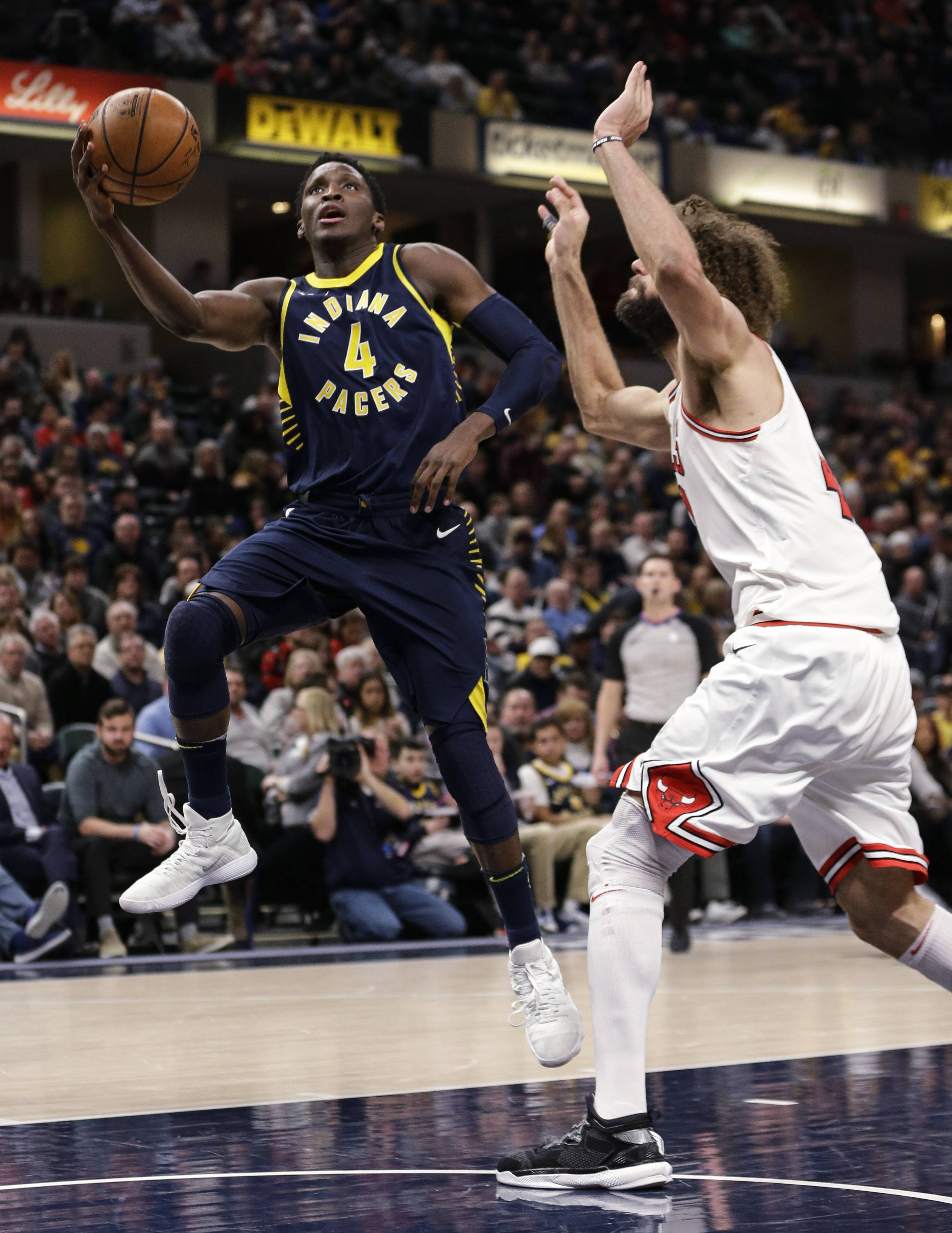 Road-weary Bulls get overwhelmed by Pacers, Oladipo