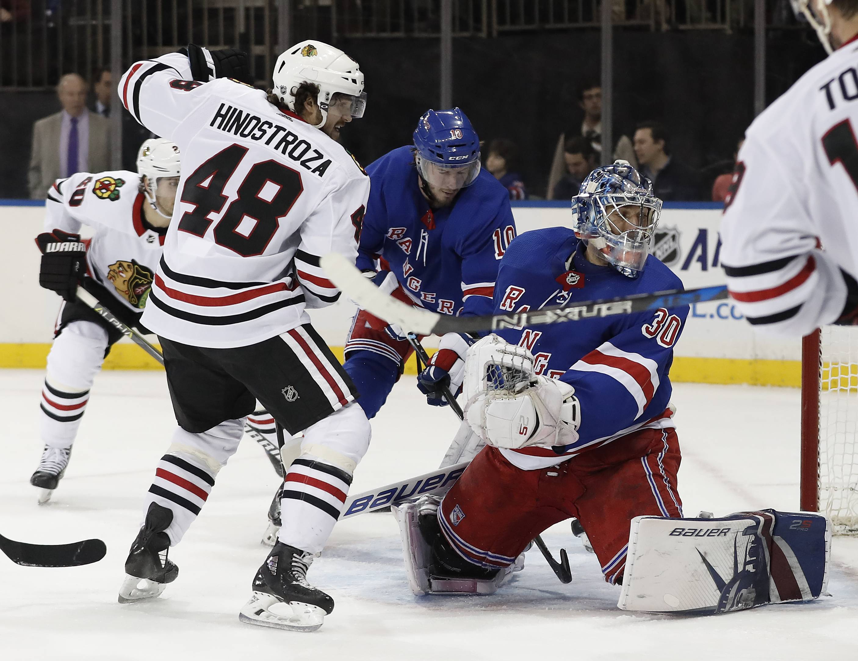 Chicago Blackhawks left wing Vinnie Hinostroza, seen here scoring against New York Rangers goaltender Henrik Lundqvist last Wednesday, has added a much needed spark to the top line.