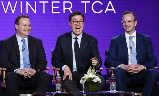 "Stephen Colbert, center, executive producer of the Showtime animated series ""Our Cartoon President,"" takes part in a panel discussion on the show with fellow executive producer Chris Licht, left, and showrunner/executive producer/writer R.J. Fried at the Television Critics Association Winter Press Tour on Saturday, Jan. 6, 2018, in Pasadena, Calif. (Photo by Chris Pizzello/Invision/AP)"