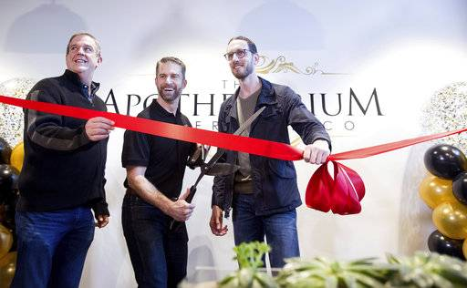 California State Sen. Scott Weiner, right, celebrates the opening of The Apothecarium for recreational marijuana sales in San Francisco on Saturday, Jan. 6, 2018. Joining him are The Apothecarium co-founder and CEO Ryan Hudson, center, and San Francisco Supervisor Jeff Sheehy. (AP Photo/Noah Berger)