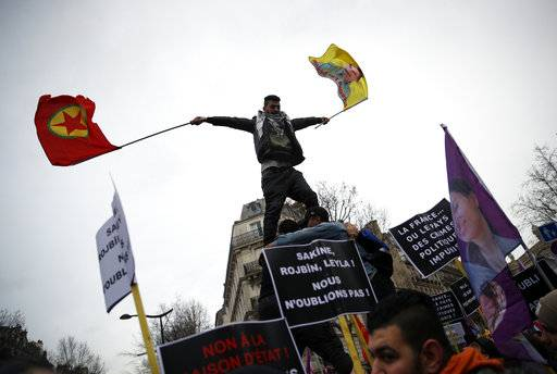 Kurdish demonstrators and supporters of jailed PKK leader Abdullah Ocalan protest on the fifth anniversary of the killing of three Kurdish women, in Paris, Saturday, Jan.6, 2018. Kurds from all over Europe demonstrate five years after the assassination of three Kurdish activists Sakine Cansiz, Fidan Dogan and Leyla Soylemez in Paris. (AP Photo/Christophe Ena)