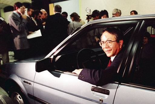 "FILE - In this Tuesday, Dec. 18, 1984, file photo, United Motor Manufacturing Co. President Tatsuro Toyoda gets in the drivers seat of the newly unveiled sporty 4-door subcompact ""Nova"" in the new Fremont, Calif., United Motor Manufacturing Co. plantjointly jowned by General Motors and Toyota. Toyoda, a former president of Toyota Motor Corp., who led its climb to rank among the world's top automakers, and the son of the Japanese automaker's founder, has died. He was 88. (Toyota Motor Corp. via AP)(AP Photo/Paul Sakuma)"
