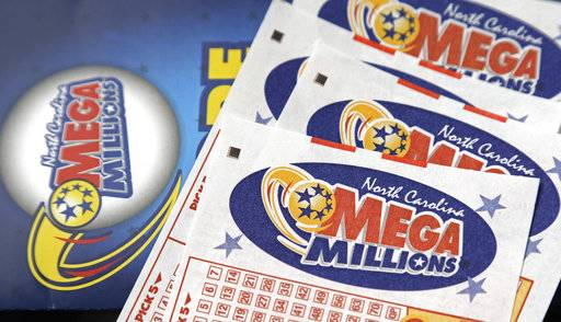 FILE - In this July 1, 2016, file photo, Mega Millions lottery tickets rest on a counter at a Pilot travel center near Burlington, N.C. The jackpot for the Mega Millions lottery game has climbed to over $450 million, just hours before the drawing, Friday, Jan. 5, 2018. (AP Photo/Gerry Broome, File)