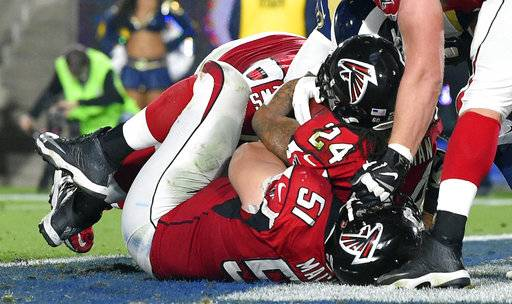 Atlanta Falcons running back Devonta Freeman (24) scores against the Los Angeles Rams during the first half of an NFL football wild-card playoff game Saturday, Jan. 6, 2018, in Los Angeles. (AP Photo/Mark J. Terrill)