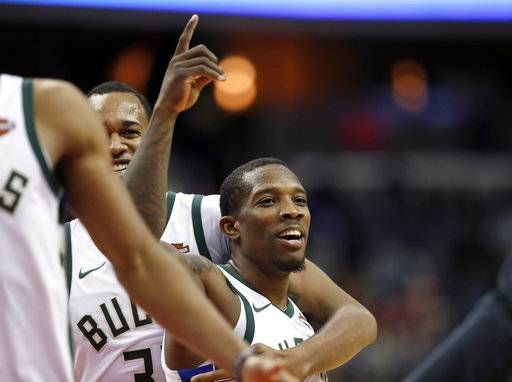 Milwaukee Bucks forward John Henson, back, celebrates with guard Eric Bledsoe after his 3-point shot during the second half of an NBA basketball game against the Washington Wizards, Saturday, Jan. 6, 2018, in Washington. The Bucks won 110-103. (AP Photo/Alex Brandon)