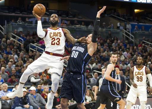 Cleveland Cavaliers forward LeBron James (23) shoots over Orlando Magic forward Aaron Gordon (00) during the first half of an NBA basketball game in Orlando, Fla., Saturday, Jan. 6, 2018. (AP Photo/Willie J. Allen Jr.)