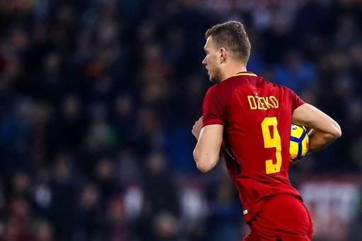 Roma's Edin Dzeko reacts after scoring during the Serie A soccer match between Roma and Atalanta at the Olympic stadium in Rome, Saturday, Jan. 6, 2018. (Angelo Carconi/ANSA via AP)