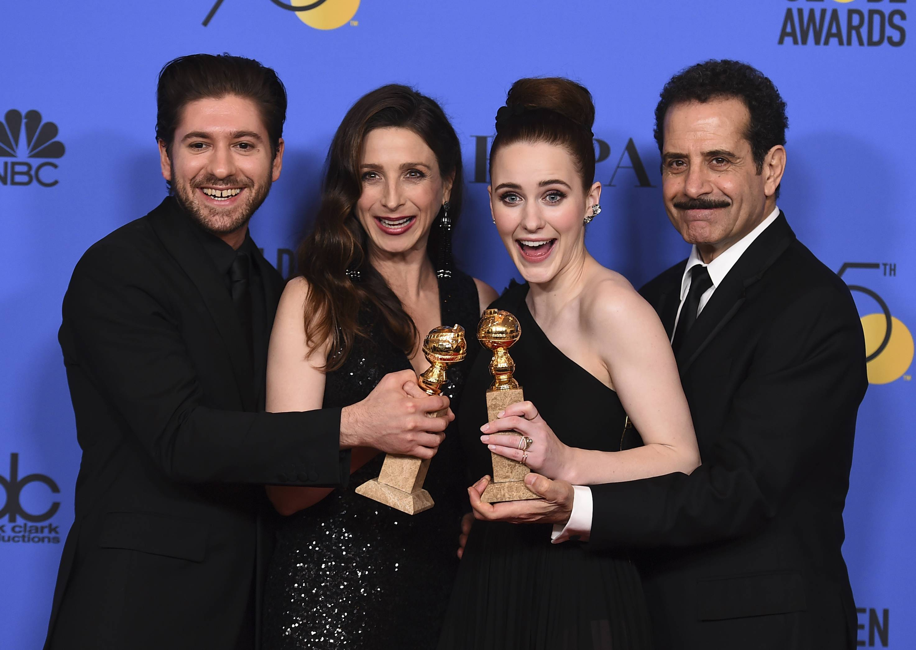 "Michael Zegen, from left, Marin Hinkle, Rachel Brosnahan and Tony Shalhoub pose in the press room with the award for best television series - musical or comedy for ""The Marvelous Mrs. Maisel"" at the 75th annual Golden Globe Awards at the Beverly Hilton Hotel on Sunday."