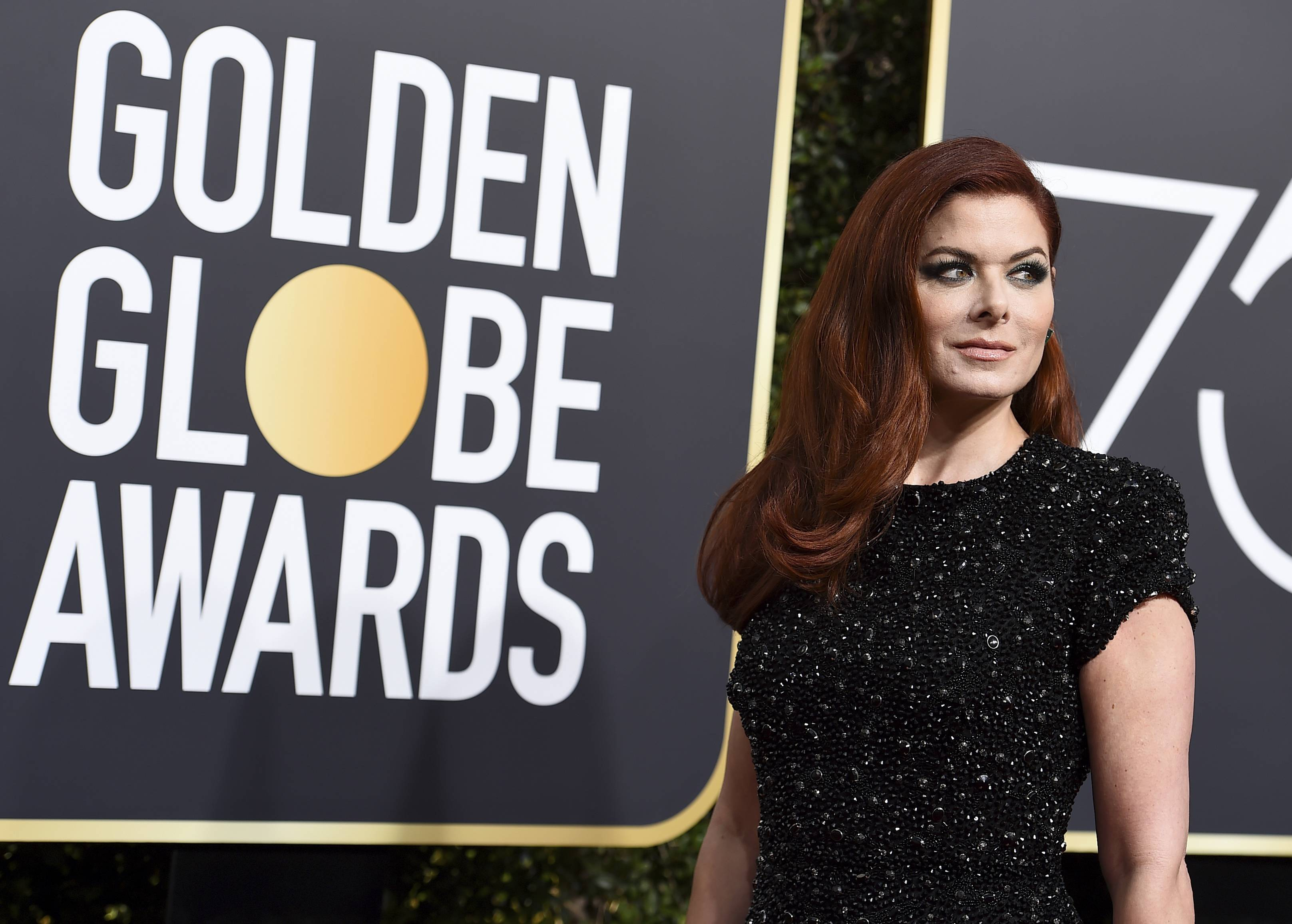 Debra Messing arrives at the 75th annual Golden Globe Awards at the Beverly Hilton Hotel on Sunday.