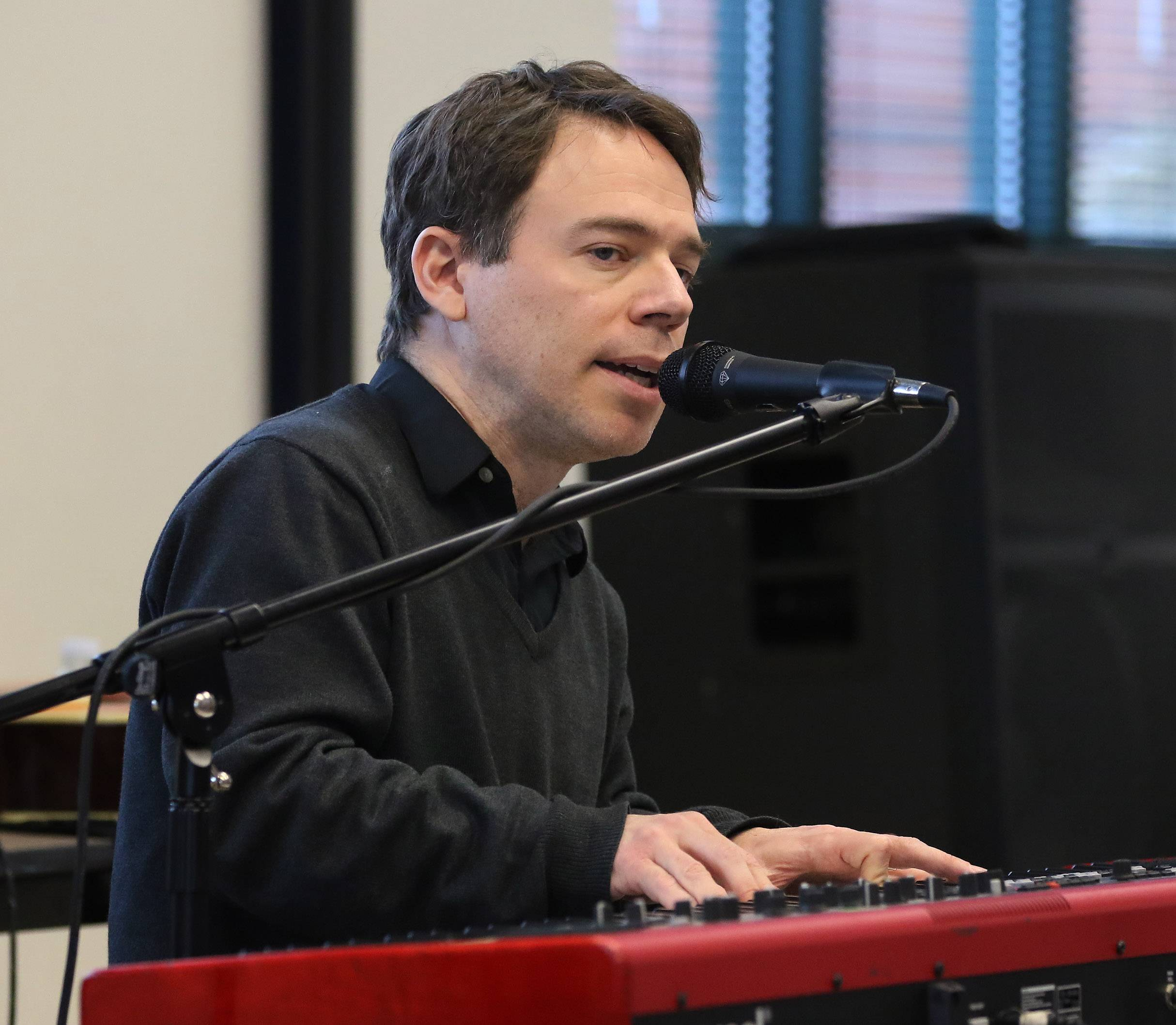 "Musician and composer David Nagler entertains patrons with ""Carl Sandburg's Chicago Poems"" at the Grayslake Public Library on Sunday. Nagler set Sandburg's poems to music and is performing them as part of the Illinois Bicentennial."
