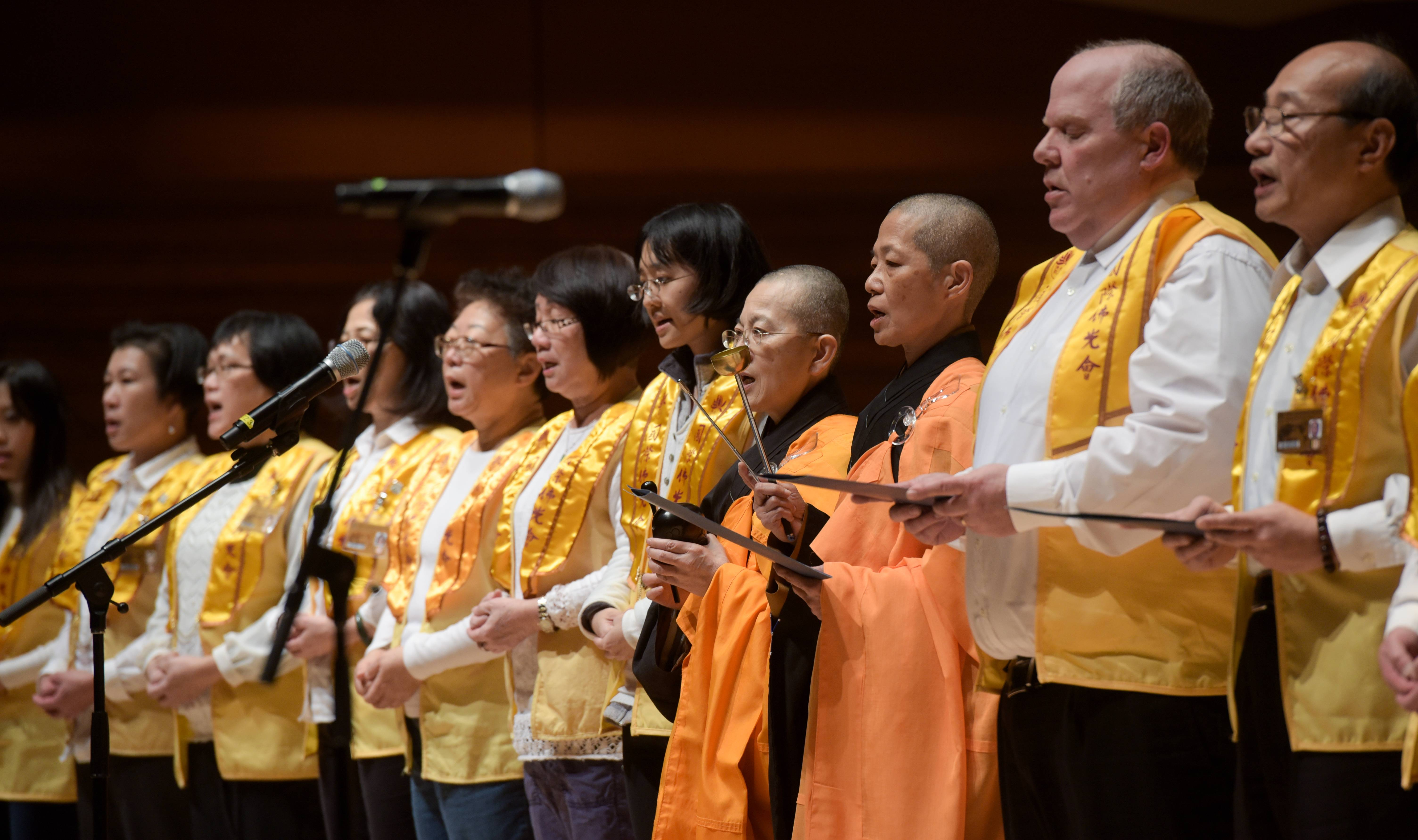 Members of the International Buddhist Progress Society perform during the 13th annual World Peace Day Interfaith Prayer Service at North Central College's Wentz Concert Hall on Sunday.