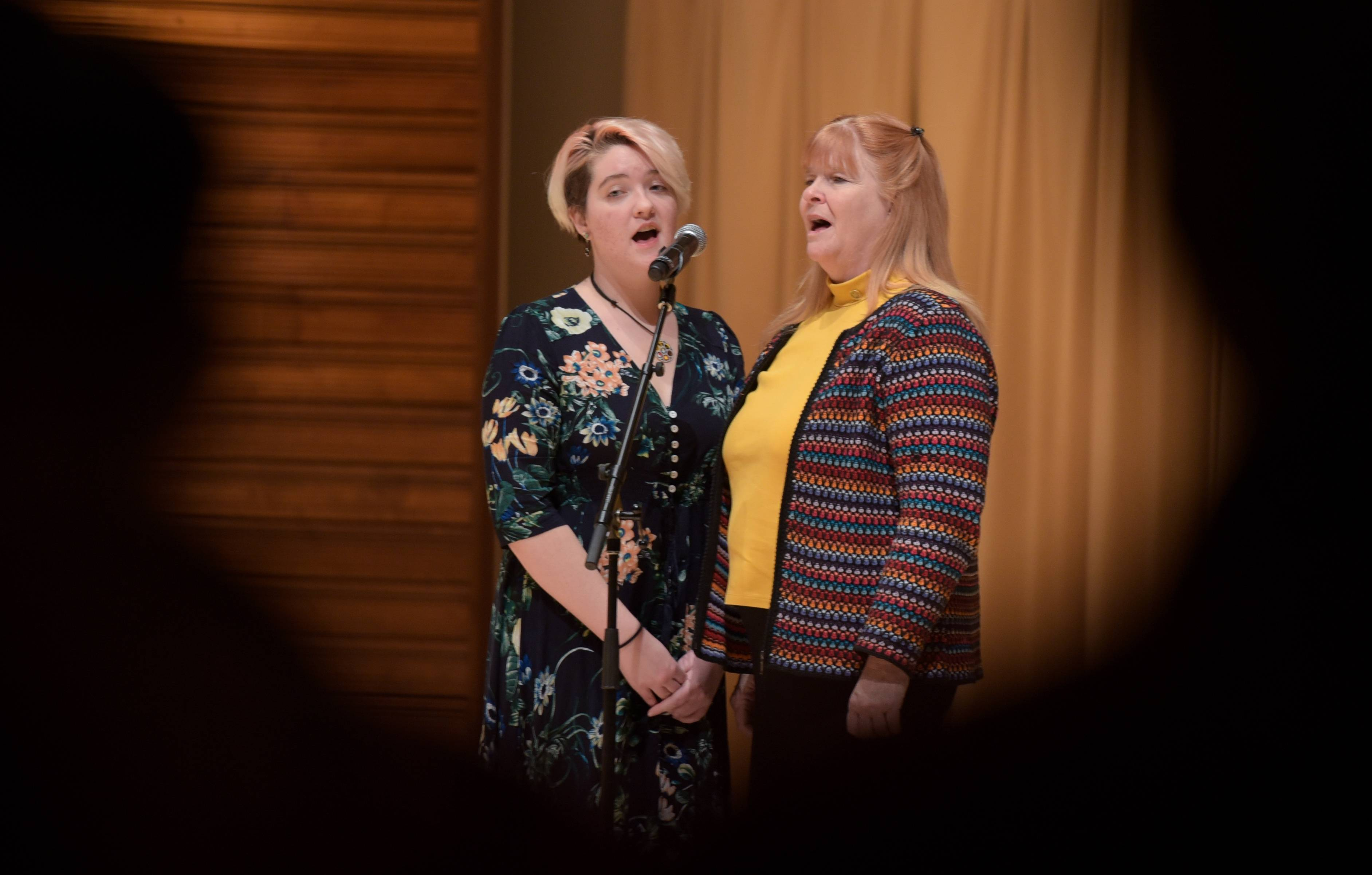 "Becky Trombly-Freytag and her mother, Kelley Trombly-Freytag, of the DuPage Unitarian Universalist Church lead the audience in singing ""Let There Be Peace On Earth"" on Sunday during the 13th annual World Peace Day Interfaith Prayer Service in Naperville."