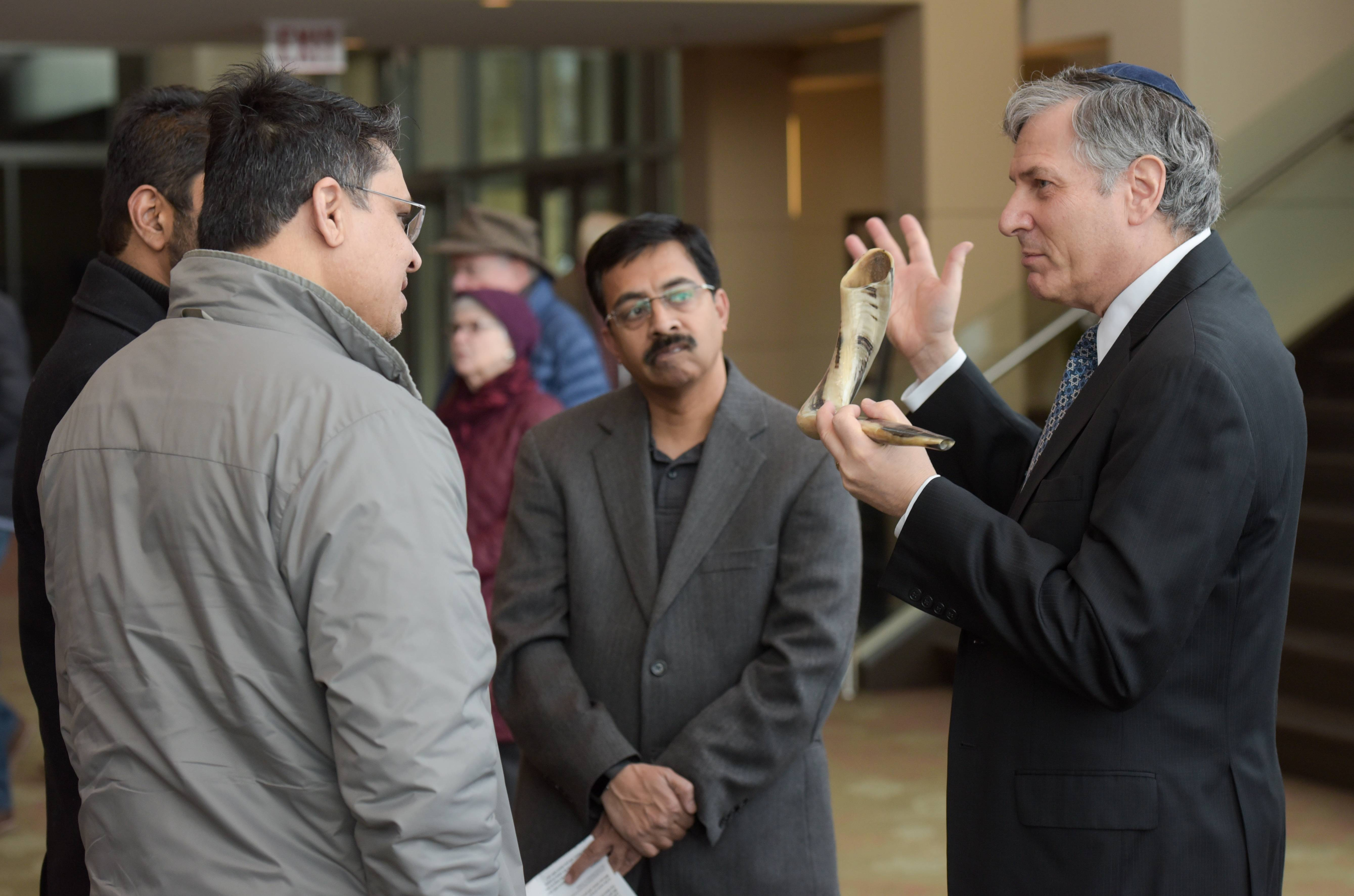 Sami Siddiqui, Shafeek Abooubaker and Syed Abedi of the Islamic Center of Naperville talk Sunday with Bernie Newman from Congregation Beth Shalom during the 13th annual World Peace Day Interfaith Prayer Service at North Central College's Wentz Concert Hall.