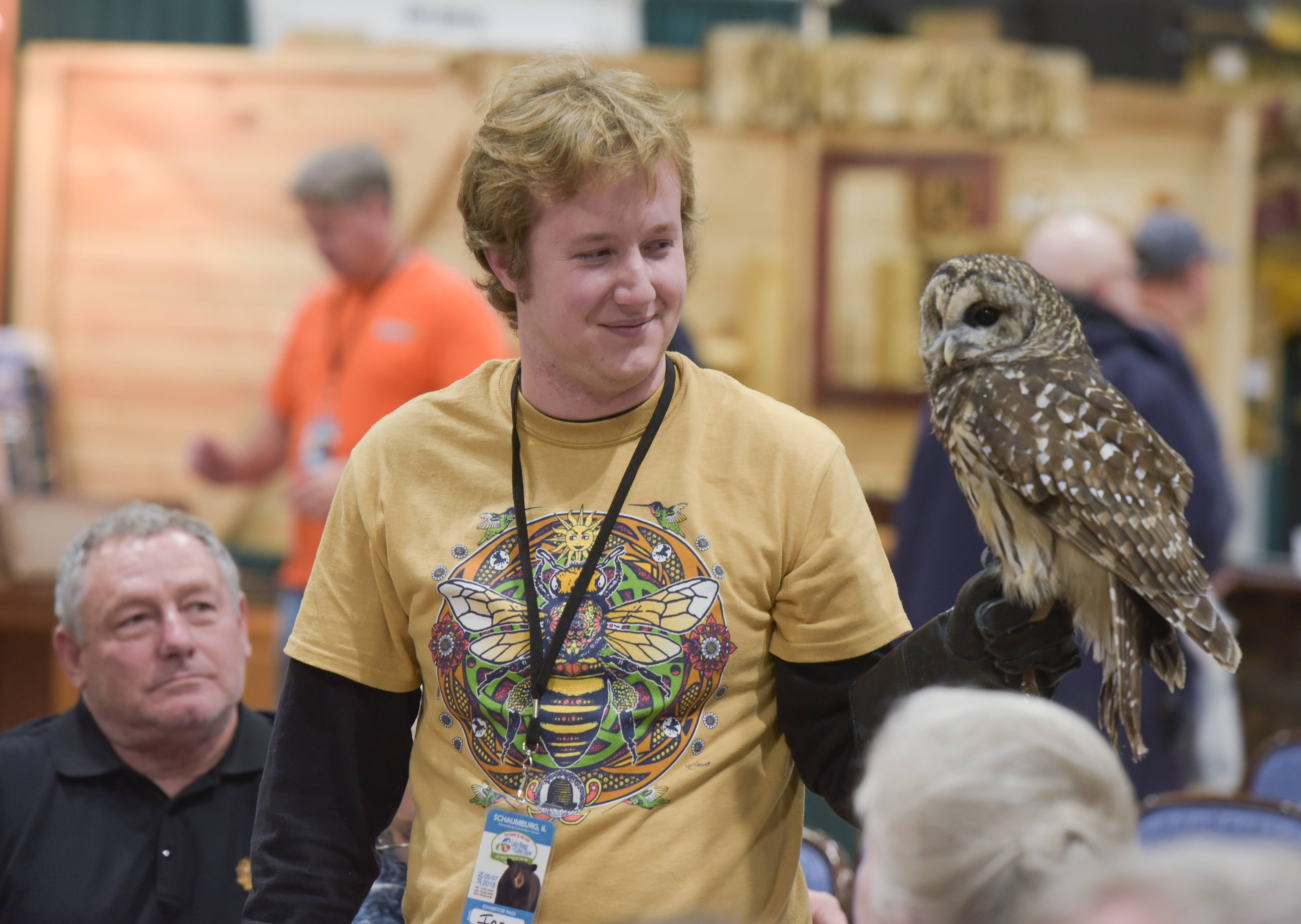 "Ian Ableson, of the Organization for Bat Conservation, shows off a ""Barred"" owl during a talk by organization director Rob Mies, during the annual Schaumburg Lake Home & Cabin Show at the Schaumburg Convention Center on Sunday."