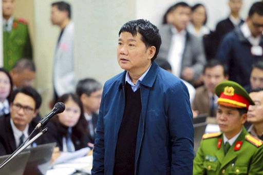 "Dinh La Thang appears in court in Hanoi, Vietnam, Monday, Jan. 8, 2018. Vietnam opened a major corruption trial Monday against defendants who include the former senior Communist official and a former oil executive the Vietnamese government is accused of snatching from Germany. Thang, former Politburo member and former chairman of state energy giant PetroVietnam is accused of ""deliberately violating state economic management regulations. (Doan Tan/Vietnam News Agency via AP)"