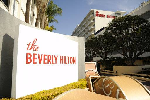 FILE - In this Jan. 8, 2015 file photo, The Beverly Hilton is pictured during the 72nd Annual Golden Globe Awards Preview Day at the Beverly Hilton in Beverly Hills, Calif. The 75th Golden Globe Awards will be handed out on Sunday, Jan. 7, 2018, at a ceremony that is being held under the cloud of the sexual misconduct scandal that started with several high-profile actresses accusing Harvey Weinstein of sexual harassment or abuse. Many actresses say they are planning to wear black Sunday to show solidarity with victims of harassment and abuse. (Photo by Chris Pizzello/Invision/AP, File)